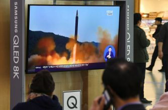 People watch a television news screen showing file footage of a North Korean missile launch, at a railway station in Seoul on October 31, 2019. - North Korea fired two projectiles on October 31, the South's military said, with nuclear talks between Pyongyang and Washington at a deadlock. (Photo by Jung Yeon-je / AFP)
