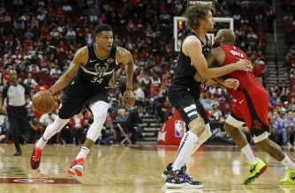 HOUSTON, TX - OCTOBER 24: Giannis Antetokounmpo #34 of the Milwaukee Bucks drives to the basket defended by PJ Tucker #17 of the Houston Rockets in the first half at Toyota Center on October 24, 2019 in Houston, Texas. NOTE TO USER: User expressly acknowledges and agrees that, by downloading and or using this photograph, User is consenting to the terms and conditions of the Getty Images License Agreement.   Tim Warner/Getty Images/AFP