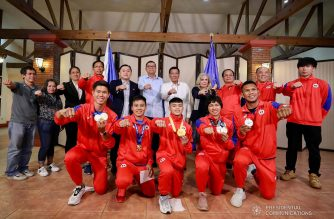 President Rodrigo Roa Duterte strikes his signature pose with the Filipino athletes who have brought home medals from various international competitions during their meeting at the Malago Clubhouse in Malacañang on October 16, 2019. RICHARD MADELO/PRESIDENTIAL PHOTO