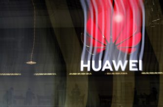 (FILES) In this file photo taken on October 15, 2019 an illuminated Huawei sign is on display during the 10th Global mobile broadband forum hosted by Huawei in Zurich on October 15, 2019. (Photo by STEFAN WERMUTH / AFP)