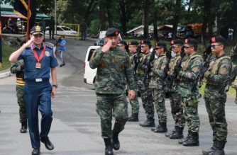 National Capital Region Police Office chief Guillermo Eleazar leads the changing of the guard at the New Bilibid Prison in Muntinlupa on Tuesday, Oct. 8./NCRPO/