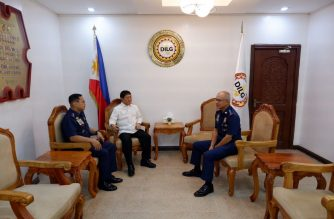 Interior Secretary Eduardo Año is seen speaking with Oscar Albayalde, who on Monday, Oct. 14, announced he had stepped down from the post of PNP chief. Also present in the picture was PNP deputy chief of administration Lt. Gen. Archie Gamboa, who was named the PNP officer-in-charge./Office of the Chief PNP/