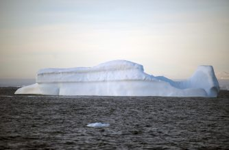 (FILE) An iceberg is pictured in the western Antarctic peninsula, on March 02, 2016. (Photo by EITAN ABRAMOVICH / AFP)