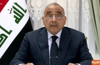 An image grab taken from Iraqiya state TV channel shows Iraqi Prime Minister Adel Abdel Mahdi giving his first televised speech following the outbreak of deadly protests in Baghdad on October 4, 2019. (Photo by Handout / IRAQIYA TV / AFP)