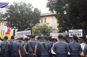 Policemen were deployed on Tuesday, Oct. 8, in front of the Supreme Court where Vice President Leni Robredo supporters held a rally to urge the SC to junk the electoral protest filed by former Senator Bongbong Marcos./Moira Encina/Eagle News/