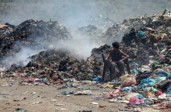 A Yemeni youth looks behind him as he sits on a chair at a garbage dump in the third-largest city Taez in southwestern Yemen, on October 26, 2019. - Mounds of stinking garbage line the streets of Yemen's historic city of Taez, once renowned as one of the most beautiful places in the country, but now torn apart by war. The city in the highlands of southwestern Yemen has become a breeding ground for mosquitos as well as deadly outbreaks of diseases like cholera, as decaying refuse leaches into waterways. (Photo by AHMAD AL-BASHA / AFP)