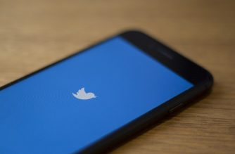 (FILES) In this file photo taken on July 10, 2019 the Twitter logo is seen on a phone in this photo illustration in Washington, DC. - Twitter said on October 30, 2019 that it would stop accepting political advertising globally on its platform, responding to growing concerns over misinformation from politicians on social media. (Photo by Alastair Pike / AFP)