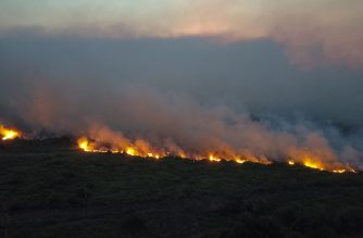 """Handout picture released by Mato Grosso do Sul State Government showing an aerial view of a forest fire at the Pantanal ecoregion of Brazil, municipality of Corumba, Mato Grosso do Sul state, on October 29, 2019. - Massive fire of """"proportions never before recorded"""" are devastating three municipalities in the Pantanal region in southern Brazil, the state government Mato Grosso do Sul reported Thursday, describing the situation as """"critical"""". (Photo by Chico Ribeiro / Mato Grosso do Sul State Government / AFP) / RESTRICTED TO EDITORIAL USE - MANDATORY CREDIT """"AFP PHOTO / Mato Grosso do Sul State Government  / Chico RIBEIRO """" - NO MARKETING - NO ADVERTISING CAMPAIGNS - DISTRIBUTED AS A SERVICE TO CLIENTS"""