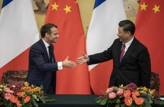French President Emmanuel Macron (L) shakes hands with Chinese President Xi Jinping following a signing ceremony at the Great Hall of the People in Beijing on November 6, 2019. (Photo by NICOLAS ASFOURI / POOL / AFP)