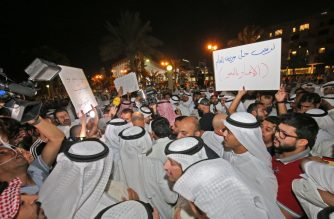 Kuwaiti demonstrators take part in a demonstration against corruption in Kuwait City on November 6, 2019. - Hundreds protested in front of Kuwait's parliament on Wednesday evening against the state's perceived unwillingness to fight corruption, in a country where such events have periodically triggered political crises. (Photo by Yasser Al-Zayyat / AFP)