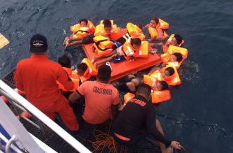 "This handout photo taken and released on November 7, 2019 by the Philippine Coast Guard shows passengers of the ill-fated MV Siargao Princess ferry after being rescued from the waters off Sibunga Cebu in the central Philippines. - Philippine authorities launched a rescue operation on November 7 after a ferry with at least 60 people onboard capsized in rough seas, the coast guard said. (Photo by Handout / Philippine coast Guard (PCG) / AFP) / -----EDITORS NOTE --- RESTRICTED TO EDITORIAL USE - MANDATORY CREDIT ""AFP PHOTO / PHILIPPINE COAST GUARD "" - NO MARKETING - NO ADVERTISING CAMPAIGNS - DISTRIBUTED AS A SERVICE TO CLIENTS"
