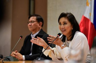 """Philippine Vice-President Leni Robredo (R) attends a press conference with Philippine Drug Enforcement Agency (PDEA) chief Aaron Aquino in Manila on November 8, 2019. - Robredo, the vocal critic that Philippine President Rodrigo Duterte has named to a lead role in his deadly drug war, on November 8 called for revamping the crackdown and ending its """"senseless"""" killing. (Photo by Maria TAN / AFP)"""