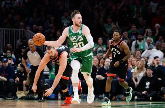 (FILES) In this file photo taken on October 25, 2019 Gordon Hayward #20 of the Boston Celtics dribbles the ball past Marc Gasol #33 and Kyle Lowry #7 of the Toronto Raptors in the second half at TD Garden in Boston, Massachusetts. - Boston forward Gordon Hayward fractured his left hand Saturday in the Celtics' 135-115 victory at San Antonio, dimming the joy of improving to 7-1 on the NBA season. (Photo by Kathryn Riley / GETTY IMAGES NORTH AMERICA / AFP)