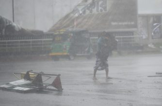 A pedestrianmakes his way under heavy rain as Cyclone Bulbul approaches the area in Khulna on November 10, 2019. - Cyclone Bulbul hit India and southern Bangladesh on November 09, leaving at least three dead as authorities in the countries ordered more than two million people to get out of the path of the storm. (Photo by Munir UZ ZAMAN / AFP)