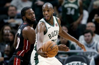 (FILES) In this file photo taken on October 25, 2019  Khris Middleton #22 of the Milwaukee Bucks dribbles the ball while being guarded by Justise Winslow #20 of the Miami Heat in the third quarter at the Fiserv Forum in Milwaukee, Wisconsin. - Milwaukee Bucks All-Star forward Khris Middleton will miss the next three to four weeks of the NBA season with a left thigh bruise, news reports said Monday. (Photo by Dylan Buell / GETTY IMAGES NORTH AMERICA / AFP)