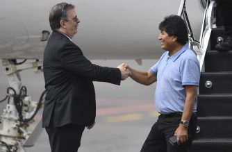 Mexican Foreign Minister Marcelo Ebrard (L) shakes hands with Bolivian ex-President Evo Morales upon his arrival in Mexico City, on November 12, 2019, where he was granted asylum after his resignation. - Landlocked Bolivia, in crisis after its president quit amid protests over a disputed election, is among Latin America's poorest countries despite having huge gas reserves. (Photo by PEDRO PARDO / AFP)