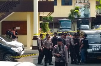Indonesian police secure their headquarters in Medan, North Sumatra, on November 13, 2019, after a suspected suicide attack occured during their morning roll call. - An explosion outside a police station in Indonesia may have been a suicide bombing, authorities and media reports said. (Photo by ATAR / AFP)