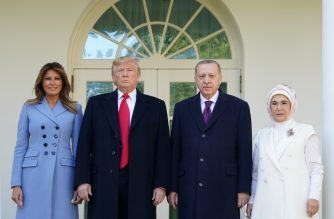 US President Donald Trump and First Lady Melania Trump greet Turkey's President Recep Tayyip Erdo?an(2ndR) and his wife Emine Erdo?an(R) outside the White House in Washington, DC on November 13, 2019. (Photo by MANDEL NGAN / AFP)