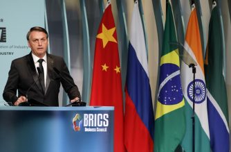 Brazil's President Jair Bolsonaro speaks during the BRICS Business Council prior to the 11th edition of the BRICS Summit, in Brasilia, on November 13, 2019. - Bolsonaro walked a diplomatic tightrope, as he seeks to boost ties with Beijing and avoid upsetting key ally Donald Trump, on the eve of a summit with their BRICS counterparts from Russia, India and South Africa. (Photo by Sergio LIMA / AFP)