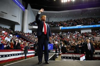 "US President Donald Trump waves to supporters as he arrives for a ""Keep America Great"" rally in Bossier City, Louisiana on November 14, 2019. (Photo by MANDEL NGAN / AFP)"