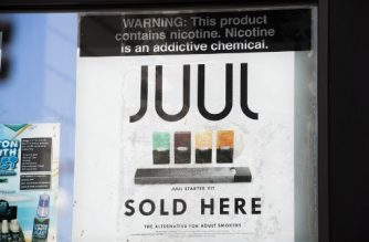 (FILES) In this file photo taken on September 17, 2019 A sign advertises Juul vaping products in Los Angeles, California. - New York on November 19, 2019 became the second state this week to sue Juul, the United States' largest electronic cigarette manufacturer, for illegally targeting minors with its marketing campaigns. The lawsuits come as the vaping industry faces intense scrutiny over an epidemic of lung ailments linked to e-cigarette use that has killed more than 40 people and sickened more than 2,000 in recent months. (Photo by Robyn Beck / AFP)