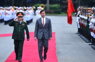 US Secretary of Defense Secretary Mark Esper (R) reviews a guard of honour alongwith Vietnam's Defence Minister Ngo Xuan Lich (L) during a welcoming ceremony at the Defense Ministry in Hanoi on November 20, 2019. (Photo by Nhac NGUYEN / AFP)