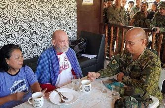 "In this undated handout photo released by Western Mindanao Command (WESMINCOM), British couple Wilma (L) and Allan Hyrons eat a meal at a military camp in Sulu island, after their rescue from Islamic State-linked militants. - Philippine soldiers on November 25 rescued a British man and his wife from Islamic State-linked jihadists nearly two months after the couple was kidnapped from their beach resort in the nation's south, authorities said. (Photo by STRINGER / Western Mindanao Command / AFP) / -----EDITORS NOTE --- RESTRICTED TO EDITORIAL USE - MANDATORY CREDIT ""AFP PHOTO / WESMINCOM "" - NO MARKETING - NO ADVERTISING CAMPAIGNS - DISTRIBUTED AS A SERVICE TO CLIENTS  - NO ARCHIVE"