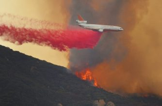 "In this photo released by the Santa Barbara County Fire Department on November 26, 2019, planes drop fire retardant as the Cave Fire burns towards East Camino Cielo in Santa Barbara, California. - A wind-driven brush fire that started late Monday November 25, 2019, afternoon in Los Padres National Forest near Highway 154 in Santa Barbara County moved quickly downhill, prompting mandatory evacuations and threatening homes. The Cave fire started just after 4 p.m. near East Camino Cielo and Painted Cave Road and by 8 p.m. had grown to at least 2,500 acres, according to the Santa Barbara County Fire Department. (Photo by Mike ELIASON / Santa Barbara County Fire Department / AFP) / RESTRICTED TO EDITORIAL USE - MANDATORY CREDIT ""AFP PHOTO / Santa Barbara County Fire Department/ Mike Eliason "" - NO MARKETING - NO ADVERTISING CAMPAIGNS - DISTRIBUTED AS A SERVICE TO CLIENTS"
