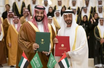 """A handout image provided by United Arab Emirates News Agency (WAM) on November 27, 2019, shows Abu Dhabi Crown Prince Sheikh Mohammed bin Zayed Al-Nahyan (R) welcoming Saudi Crown Prince Mohammed bin Salman upon his arrival in Abu Dhabi. (Photo by STRINGER / various sources / AFP) / === RESTRICTED TO EDITORIAL USE - MANDATORY CREDIT """"AFP PHOTO / HO / WAM"""" - NO MARKETING NO ADVERTISING CAMPAIGNS - DISTRIBUTED AS A SERVICE TO CLIENTS ==="""