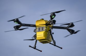 A Hermes V8MT drone of Polish firm Spartaqs is flying in the air near the company's headquarters in Mikolow, southern Poland, on November 20, 2019. - The Hermes drone designed by Spartacus will soon complete its final tests and start service as a blood transporter between a blood bank and the Institute of Cardiology in Warsaw. (Photo by Wojtek RADWANSKI / AFP)