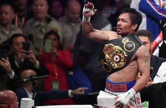 LAS VEGAS, NEVADA - JULY 20: Manny Pacquiao celebrates his split-decision victory over Keith Thurman in their WBA welterweight title fight at MGM Grand Garden Arena on July 20, 2019 in Las Vegas, Nevada.   Ethan Miller/Getty Images/AFP