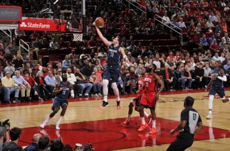 HOUSTON, TX - NOVEMBER 24 : Luka Doncic #77 of the Dallas Mavericks drives to the basket during a game against the Houston Rockets on November 24, 2019 at the Toyota Center in Houston, Texas. NOTE TO USER: User expressly acknowledges and agrees that, by downloading and or using this photograph, User is consenting to the terms and conditions of the Getty Images License Agreement. Mandatory Copyright Notice: Copyright 2019 NBAE   Bill Baptist/NBAE via Getty Images/AFP