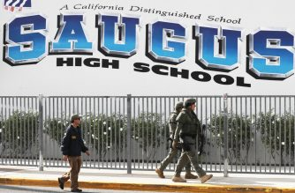 SANTA CLARITA, CALIFORNIA - NOVEMBER 14: Members of law enforcement walk at Saugus High School after a shooting at the school left two students dead and three wounded on November 14, 2019 in Santa Clarita, California. A suspect in the shooting is being treated at a local hospital for a gunshot wound to the head.   Mario Tama/Getty Images/AFP