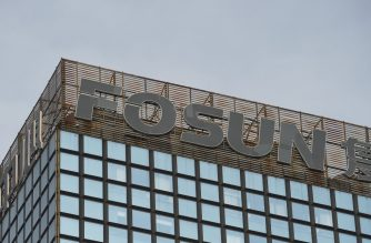 (FILE) The logo of Chinese conglomerate Fosun is seen on top of a building in Beijing on December 12, 2015 (Photo by GREG BAKER / AFP)