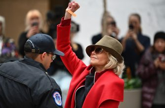 Actress Jane Fonda raises her fist before being detained by Capitol Police during a climate change protest inside of the Hart Senate Office Building on Capitol Hill in Washington, DC on November 1, 2019. (Photo by MANDEL NGAN / AFP)