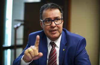 (FILE) Brazilian Deputy and chairman of the Committee on Public Security and Combating Organized Crime, Jose Augusto Rosa, known as Capitao Augusto, gestures during an interview with AFP at the National Congress in Brasilia, on October 23, 2019. (Photo by Sergio LIMA / AFP)