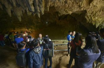 This handout photo taken on November 1, 2019 and released by Chiang Rai Provincial Public Relations Office shows people visiting Tham Luang cave in the Mae Sai district of Thailand's northern Chiang Rai province. (Photo by Handout / Chiang Rai Provincial Public Relations Office / AFP)