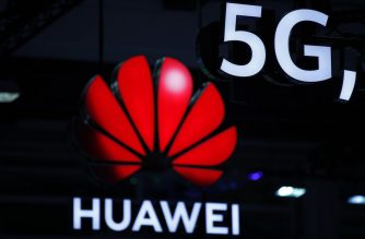 (FILE) Illuminated Huawei and 5G signs are on display during the 10th Global mobile broadband forum hosted by Chinese tech giant Huawei in Zurich on October 15, 2019. (Photo by STEFAN WERMUTH / AFP)