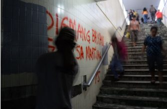 "The message of protest written on the newly-painted wall of the Lagusnilad underpass. Manila Mayor Isko Moreno warned those found vandalizing the underpass they would ""lick"" what they wrote./Manila PIO/"
