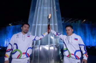 World boxing icons Manny Pacquiao and Nesthy Petecio are seen carrying the symbolic SEA Games torch together on Saturday, Nov. 30./Southeast Asian Games Youtube/