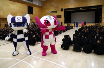 Tokyo 2020 Olympic and Paralympic Games' mascots Miraitowa (L) and Someity (R) attend a ceremony at Hoyonomori elementary school in Tokyo on November 18, 2019. (Photo by Behrouz MEHRI / AFP)