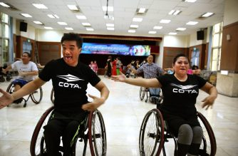 This photo taken on November 9, 2019 shows wheelchair dancers Ivy Huang (R) and Vincent Kuo (front L) with members of the Taiwan Wheelchair Dance Sport Association training for a performance at the Community Center in New Taipei City. (Photo by HSU Tsun-hsu / AFP)