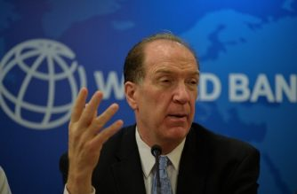 World Bank President David Malpass gestures as he speaks during a press conference at the World Bank office in New Delhi on October 26, 2019. (Photo by Sajjad  HUSSAIN / AFP)