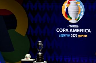 The Copa America trophy and the official ball are seen during the draw of the Copa America 2020 football tournament, at the Convention Centre in Cartagena, Colombia, on December 3, 2019. - The Copa America 2020 football tournament will be held jointly by Argentina and Colombia next year from June 12 to July 12. Asian champions Qatar and previous winner Australia will participate as invited guest teams. (Photo by Juan BARRETO / AFP)