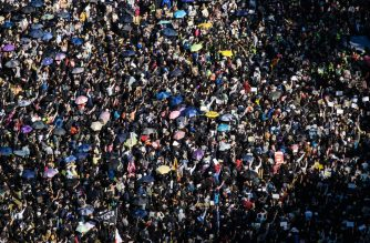 "People gather at Victoria Park for a pro-democracy rally in Hong Kong on December 8, 2019. - Vast crowds of democracy protesters thronged Hong Kong's streets on December 8 in a forceful display of support for the movement on its six-month anniversary, as organisers warned the city's pro-Beijing leaders they had a ""last chance"" to end the political crisis. (Photo by ANTHONY WALLACE / AFP)"