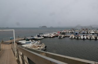 "A picture taken on December 8, 2019 shows boats and yachts inside the marina of Mamoudzou on the French Indian Ocean island of Mayotte, as Cyclone Belna is expected to make landfall. - The small French Indian Ocean island of Mayotte announced a red alert as Cyclone Belna closed in on December 8, threatening the French department of quarter of a million people. The storm was expected to make landfall in Mayotte around 9:00 pm local time (1800 GMT), according to the latest forecasts from Meteo France. A statement from officials in the French overseas department warned inhabitants to stay indoors and ""not come out under any circumstances"". (Photo by Ali AL-DAHER / AFP)"