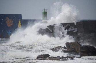 Waves hit the jetty of the port of A Guarda, northwestern Spain, during the storm Fabien, on December 21, 2019. - Violent winds and torrential rain battered Spain, Portugal and France overnight leaving at least five people dead, rescuers said, but the calm was not expected to last with storm Fabien barrelling towards the region, bringing more high winds and torrential rain. (Photo by MIGUEL RIOPA / AFP)