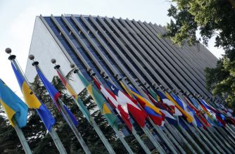 Flags fly outside of the PAHO/World Health Organization Headquarters in Washington, DC on September 27, 2016. - Measles has been eradicated from the Americas after decades of vaccination efforts, the world's first region to rid itself of the highly contagious disease, global health authorities said. Measles remains a top killer of children worldwide, and took nearly 115,000 lives in 2014 -- or about 13 deaths every hour -- according to the World Health Organization (WHO). (Photo by YURI GRIPAS / AFP)