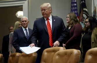 WASHINGTON, DC - OCTOBER 18: U.S. President Donald Trump and Vice President Mike Pence arrive in the Roosevelt Room for a conference call with the International Space Station on October 18, 2019 in Washington, DC. Trump spoke with NASA astronauts Jessica Meir and Christina Koch as the pair became the first women to conduct an all female space walk outside the space station.   Win McNamee/Getty Images/AFP