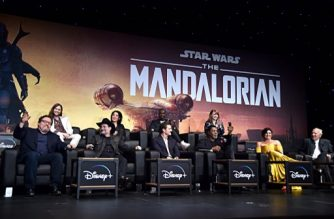 "HOLLYWOOD, CALIFORNIA - NOVEMBER 13: (L-R) Executive Producer Jon Favreau, Composer Ludwig Göransson, Executive Producer/Director Dave Filoni, Director Deborah Chow, Pedro Pascal, Rick Famuyiwa, Carl Weathers, Director Bryce Dallas Howard, Gina Carano and Werner Herzog speak onstage at the premiere of Lucasfilm's first-ever, live-action series, ""The Mandalorian,"" at the El Capitan Theatre in Hollywood, Calif. on November 13, 2019. ""The Mandalorian"" streams exclusively on Disney+.   Alberto E. Rodriguez/Getty Images for Disney/AFP"